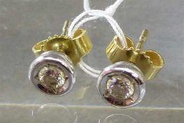 Paar Ohrstecker14 kt. Gelb- und Weißgold, 2 Brillanten zusammen ca 0,25 ct, wesselton, lupenrein,