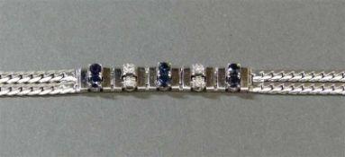 Armband14 kt. Weißgold, 6 Saphire, 4 Brillanten zus. ca 0,08 ct., 2-reihig, Flachpanzer,