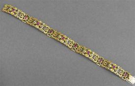 Armband, um 1920 14 kt. Gelbgold, mit 10 Rubincabochons, und 10 Diamanten besetzt, durchbrochen