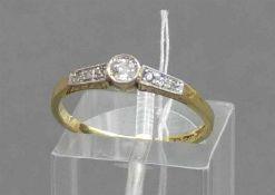 Damenring18 kt. Gelbgold und Platin, mittig 1 Altschliffdiamant ca 0,10 ct., 6 kleine Diamantrosen