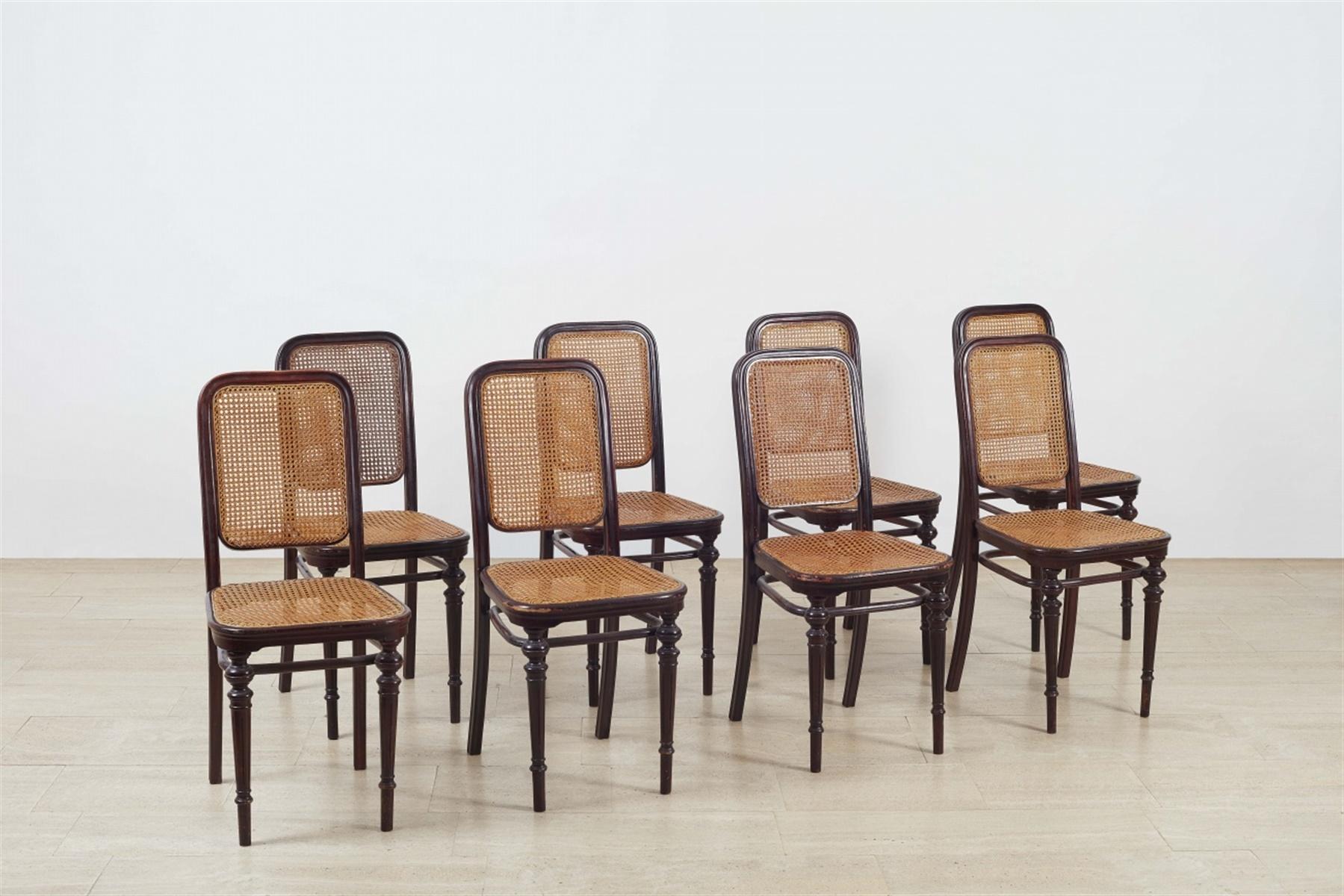 Lot 59 - Satz von acht Thonet-Stühlen Nr. 436Buche als Bugholz, dunkelrot gefasst, ersetztes Rohrgeflecht.