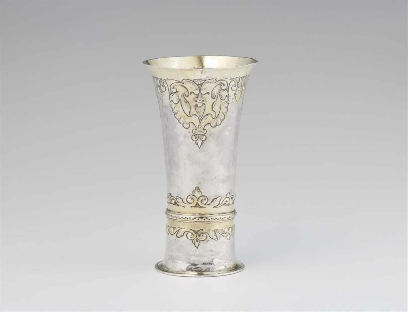 """Lot 307 - A Hermannstadt parcel gilt silver """"kluftbecher""""Slender tapering beaker with flaring rim and"""