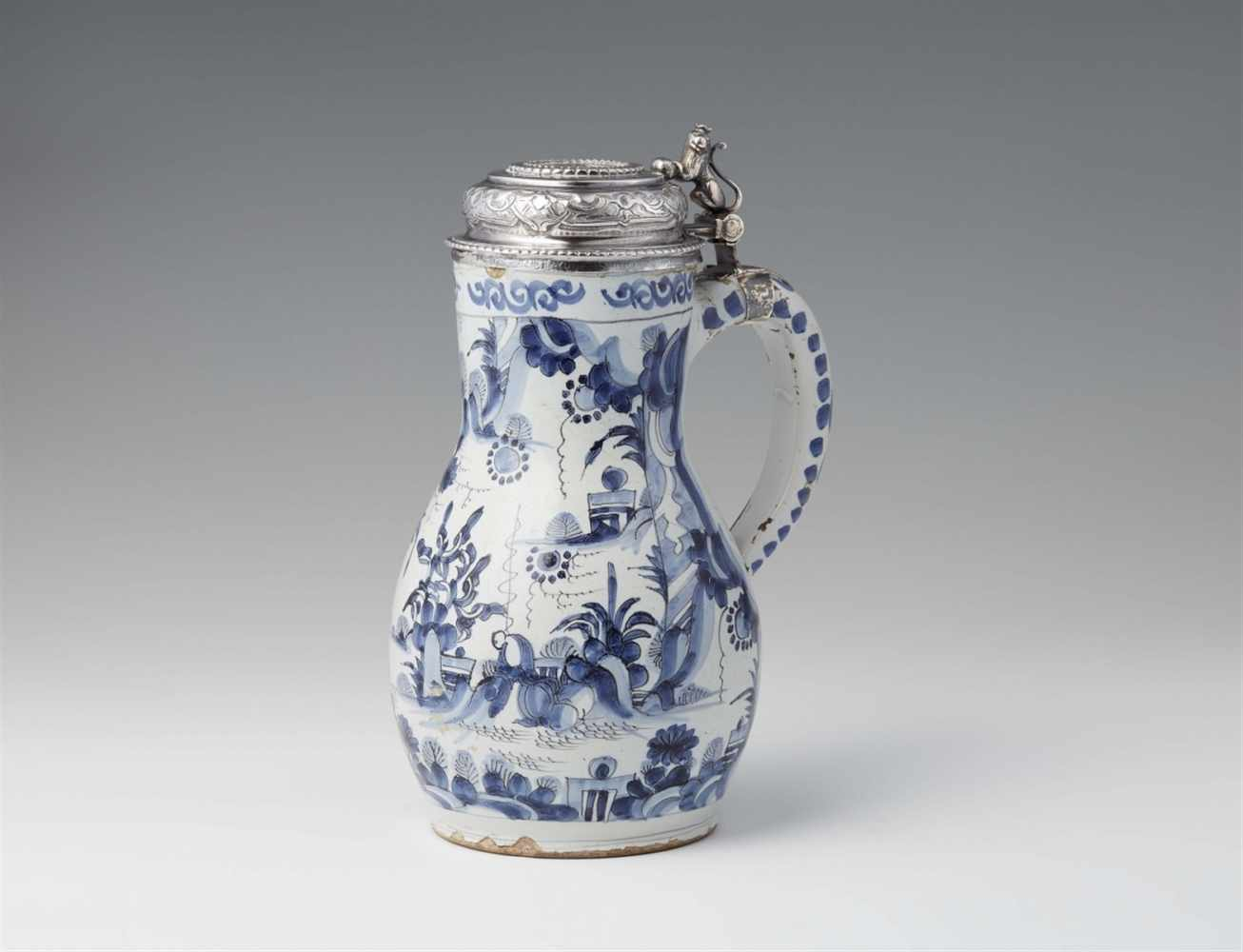 Lot 346 - A Delftware pitcher with Danish silver mountingsPear-form faience jug with blue and white