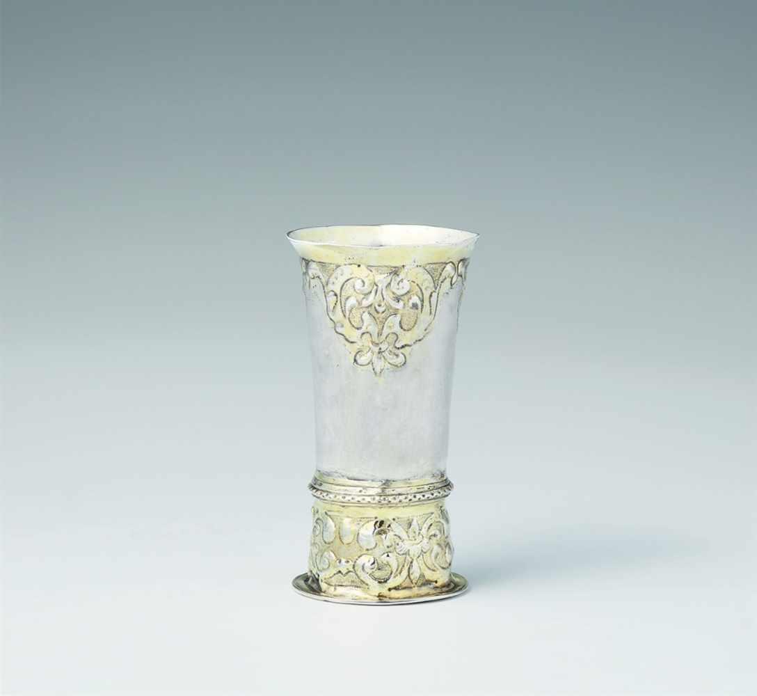 "Lot 306 - A Siebenbürgen parcel gilt silver ""kluftbecher""Narrow tapering beaker on a tall base decorated"