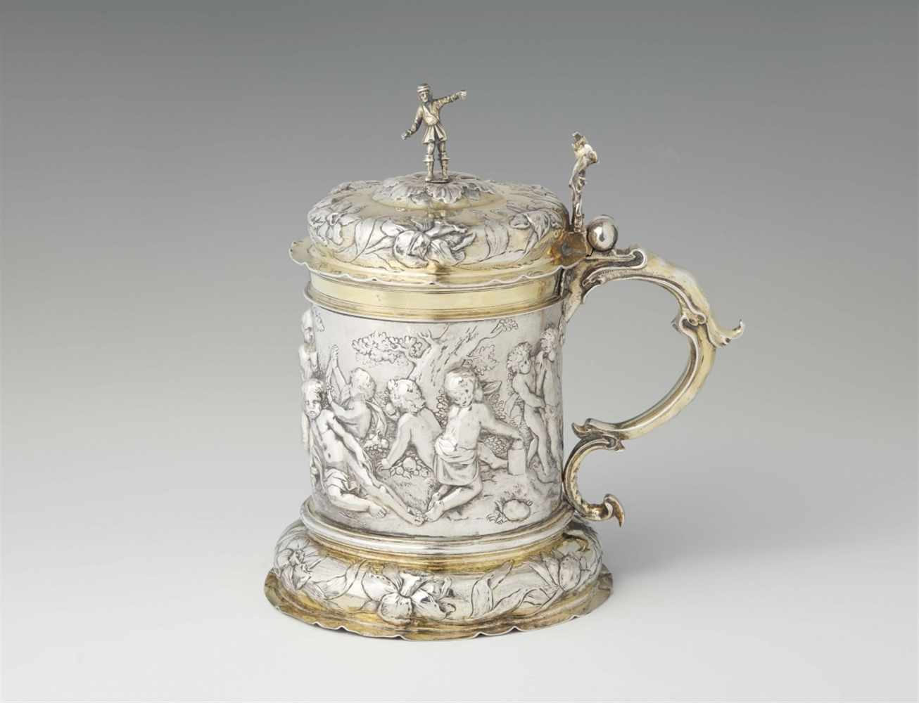 Lot 305 - An important Hamburg parcel gilt silver tankardCylindrical corpus, the basal rim and domed lid
