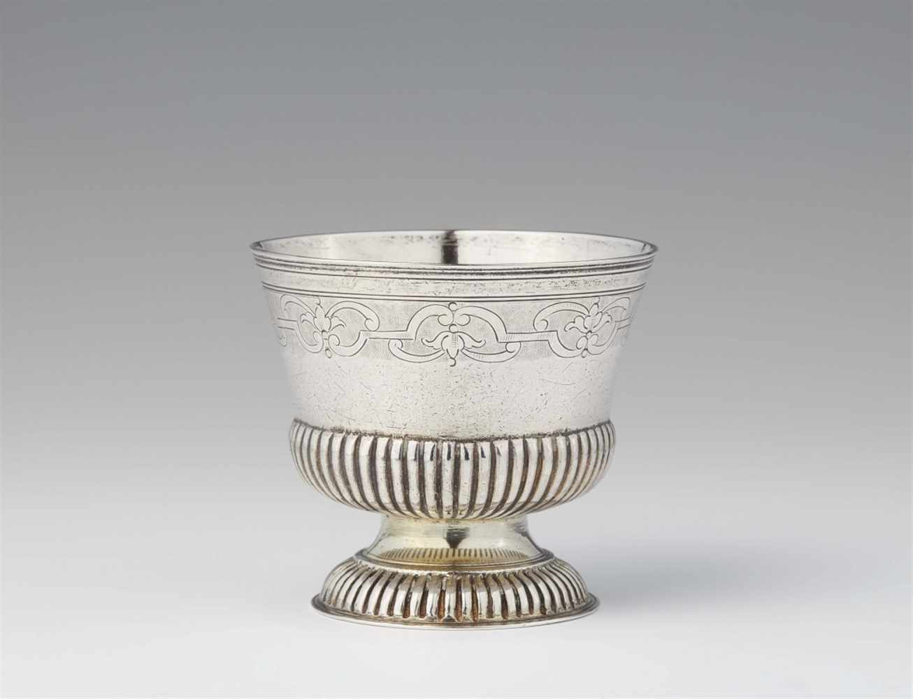 Lot 324 - An Augsburg Régence silver beakerGadrooned silver beaker with remains of gilding and engraved