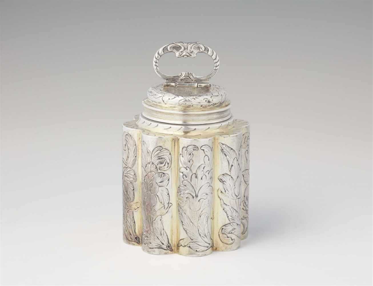 Lot 302 - An Augsburg parcel gilt silver flaskOf octagonal section with screw top and hinged handle. Decorated