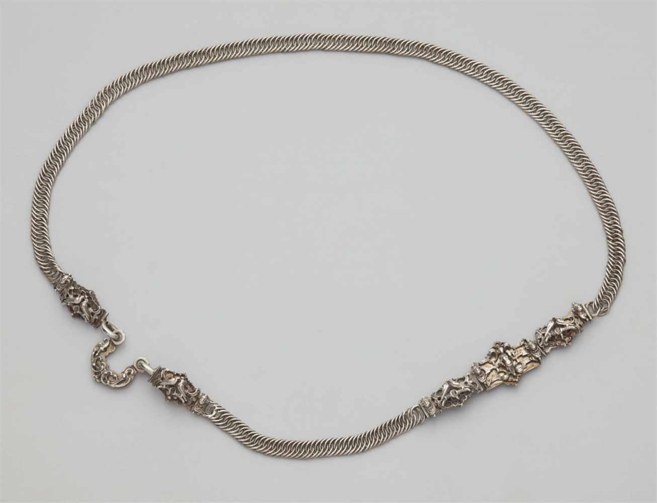 Lot 309 - A Nuremberg silver bridal beltDesigned as a flat narrow chain, the cast silver decorative clasp