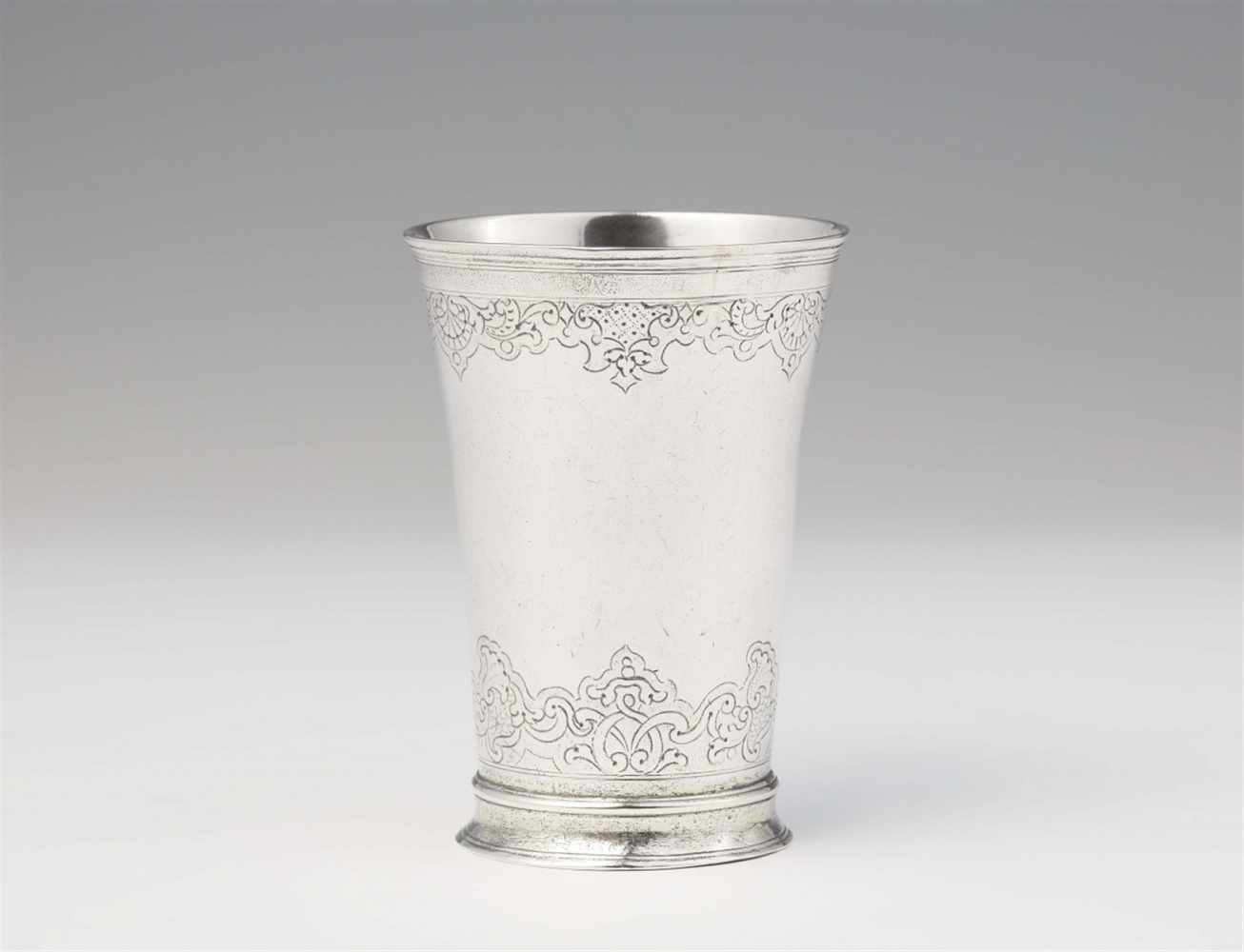 Lot 327 - An Augsburg Régence silver beakerTapering beaker with remnants of gilding on a waisted base. H 9.2