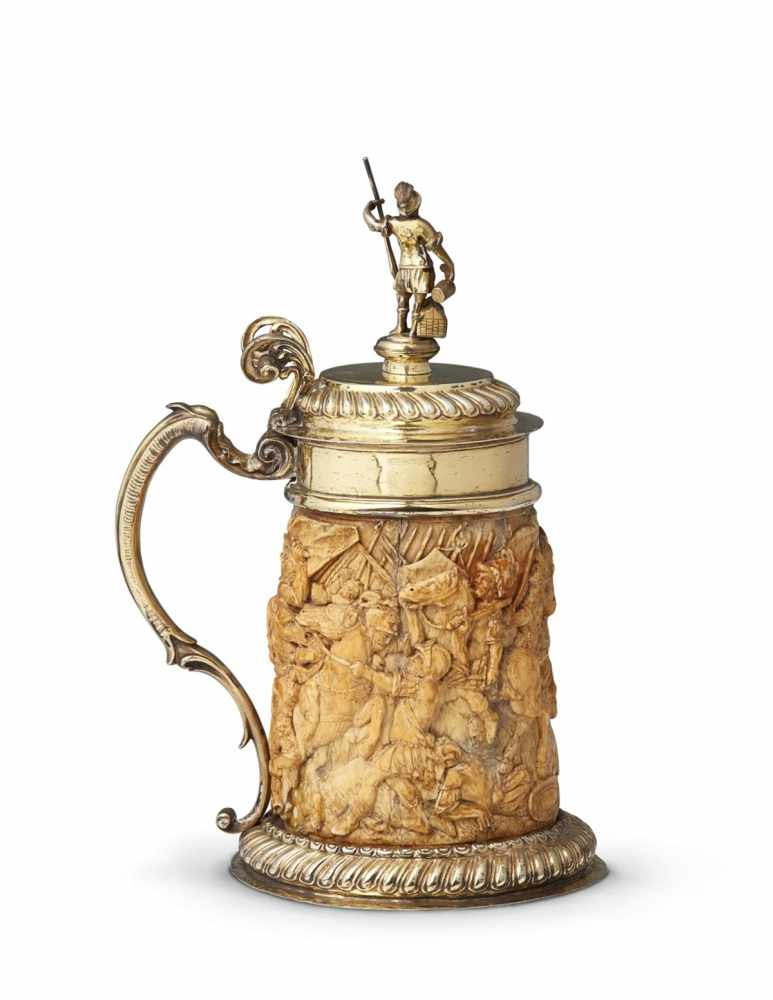 Lot 312 - A large silver-mounted ivory tankard with Saint FlorianThe foot rim and domed lid decorated with