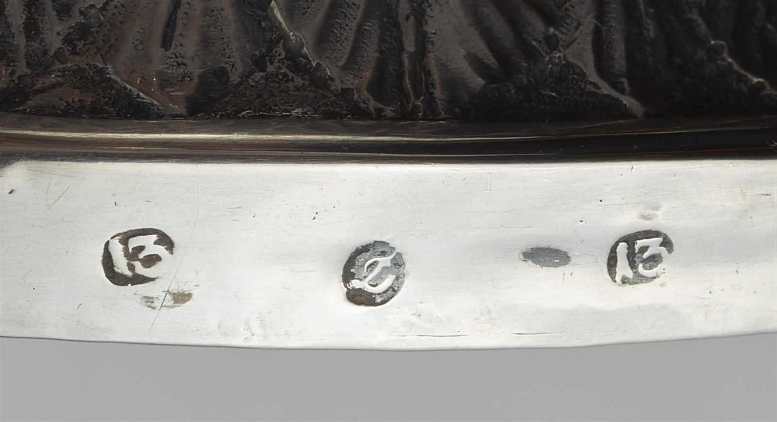 Lot 354 - A pair of Empire silver candlesticksColumn shaped candlesticks on hoof feet. H 26 cm, weight 775