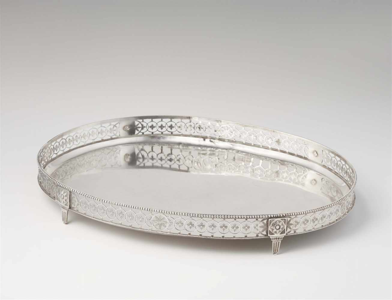Lot 340 - An Augsburg silver platterOval tray with pierced gallery rim resting on four supports. L 41.5; W 30;