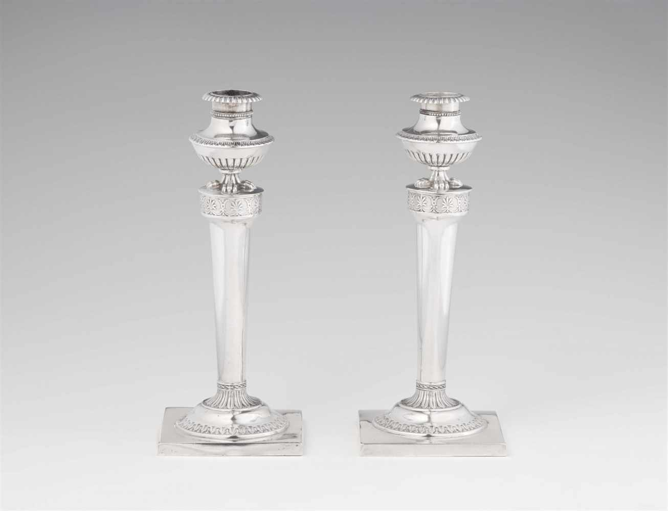 Lot 350 - A pair of Hannover silver candlesticksSlightly tapering shafts on square plinths. H 20 cm, weight
