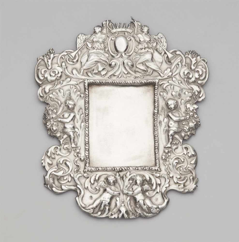 Lot 319 - An Augsburg silver votive plaque frameRectangular Baroque cartouche frame with putti and acanthus
