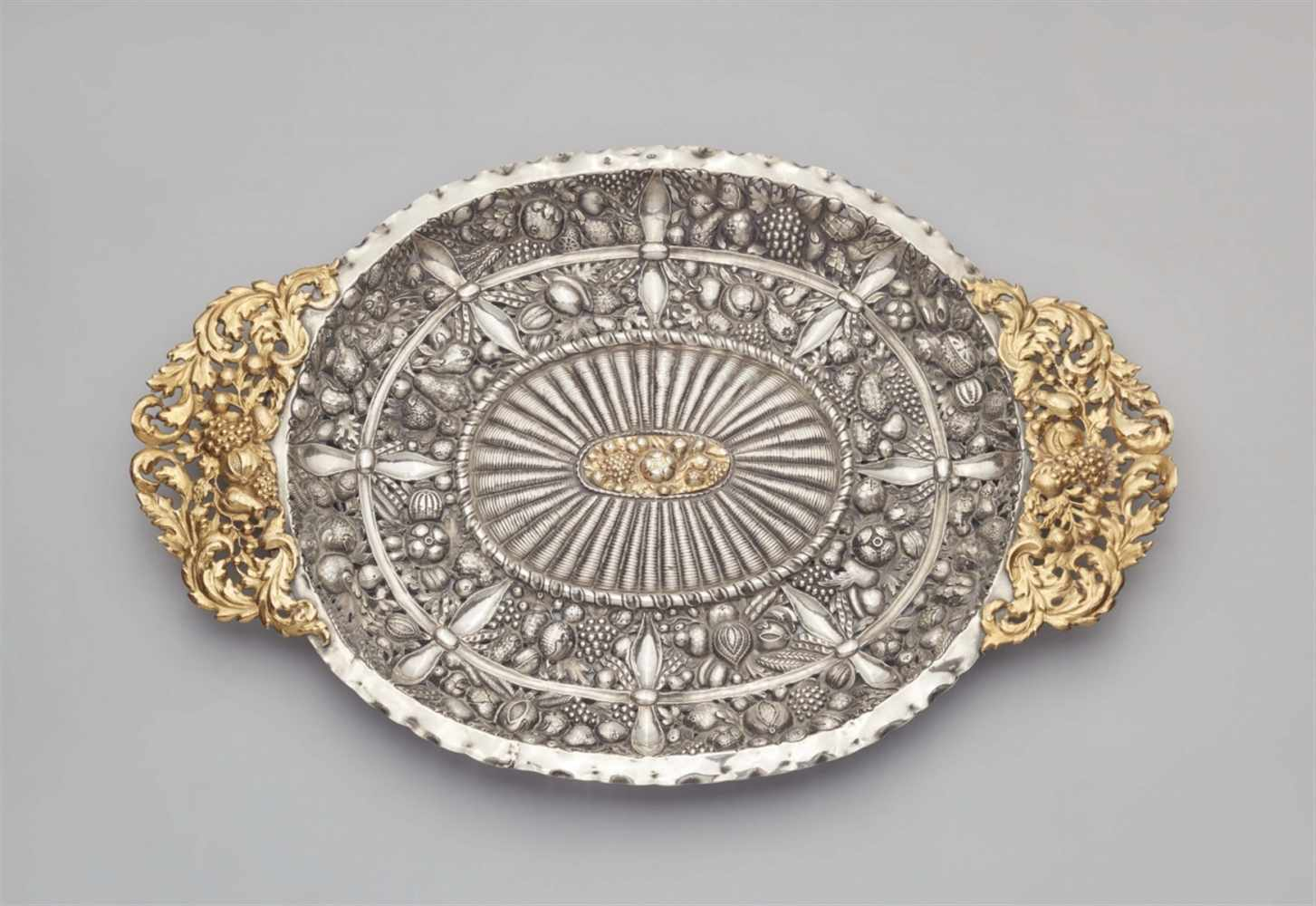 Lot 322 - An Augsburg silver sideboard platterOval platter with pierced fruit garland handles, decorated to