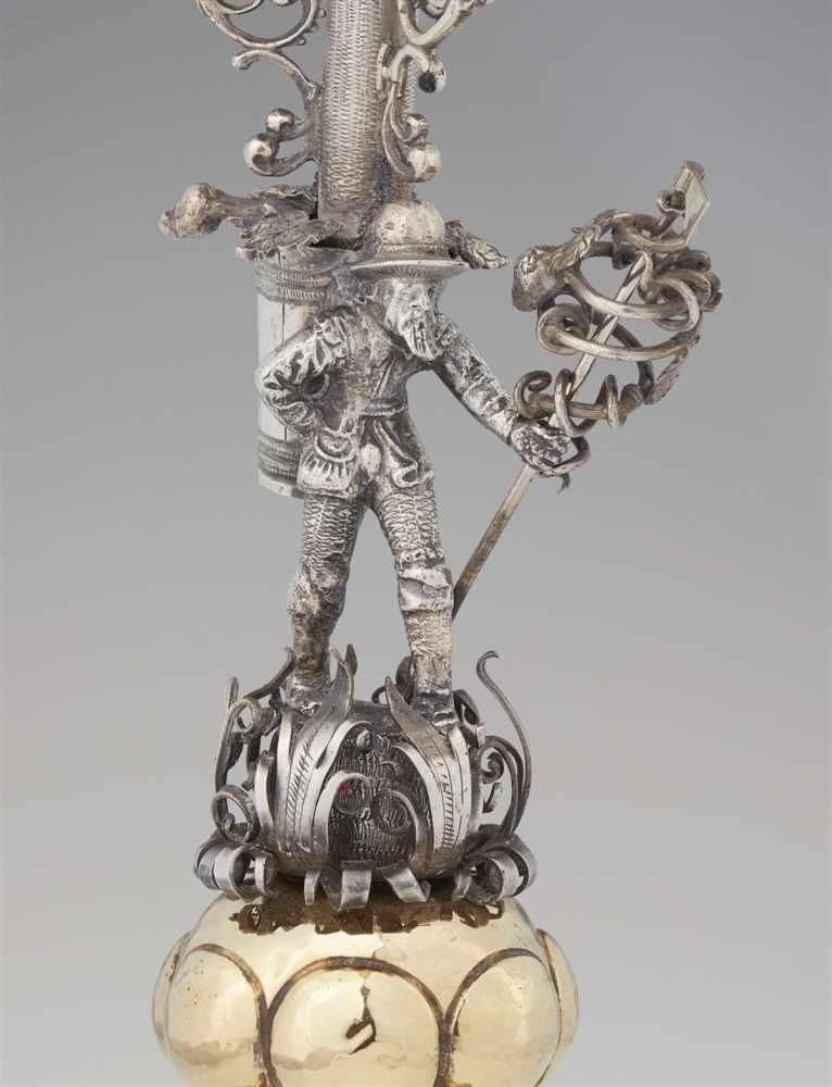 """Lot 304 - An important Renaissance parcel gilt silver goblet with a """"büttenmann"""" motifGadrooned base"""