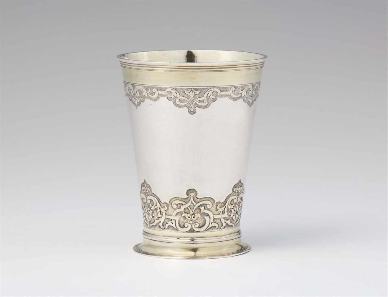 Lot 326 - An Augsburg Régence parcel gilt silver beakerTapering beaker on waisted basal ring, decorated with