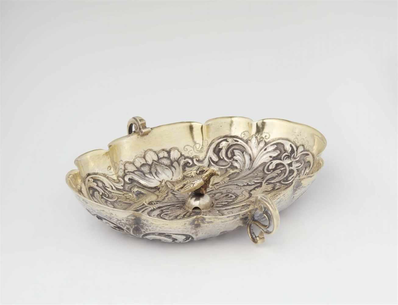 Lot 314 - An Augsburg silver gilt brandy bowl with a phoenixOval scalloped dish decorated with an engraved
