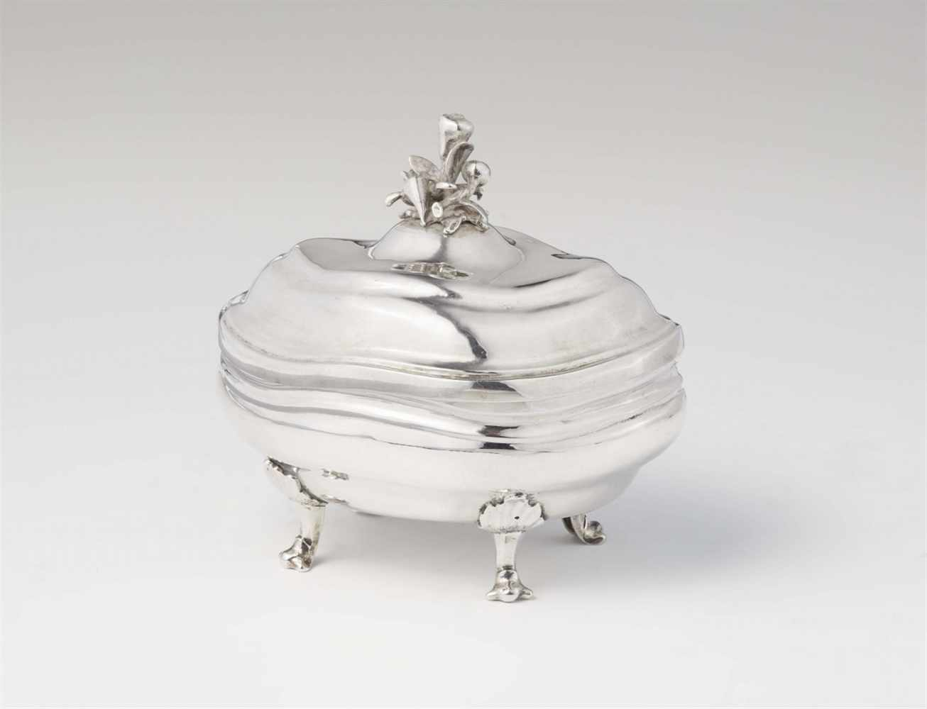 Lot 329 - An Augsburg silver sugar boxInterior gilt bombé form box with twist fluting and domed lid with a
