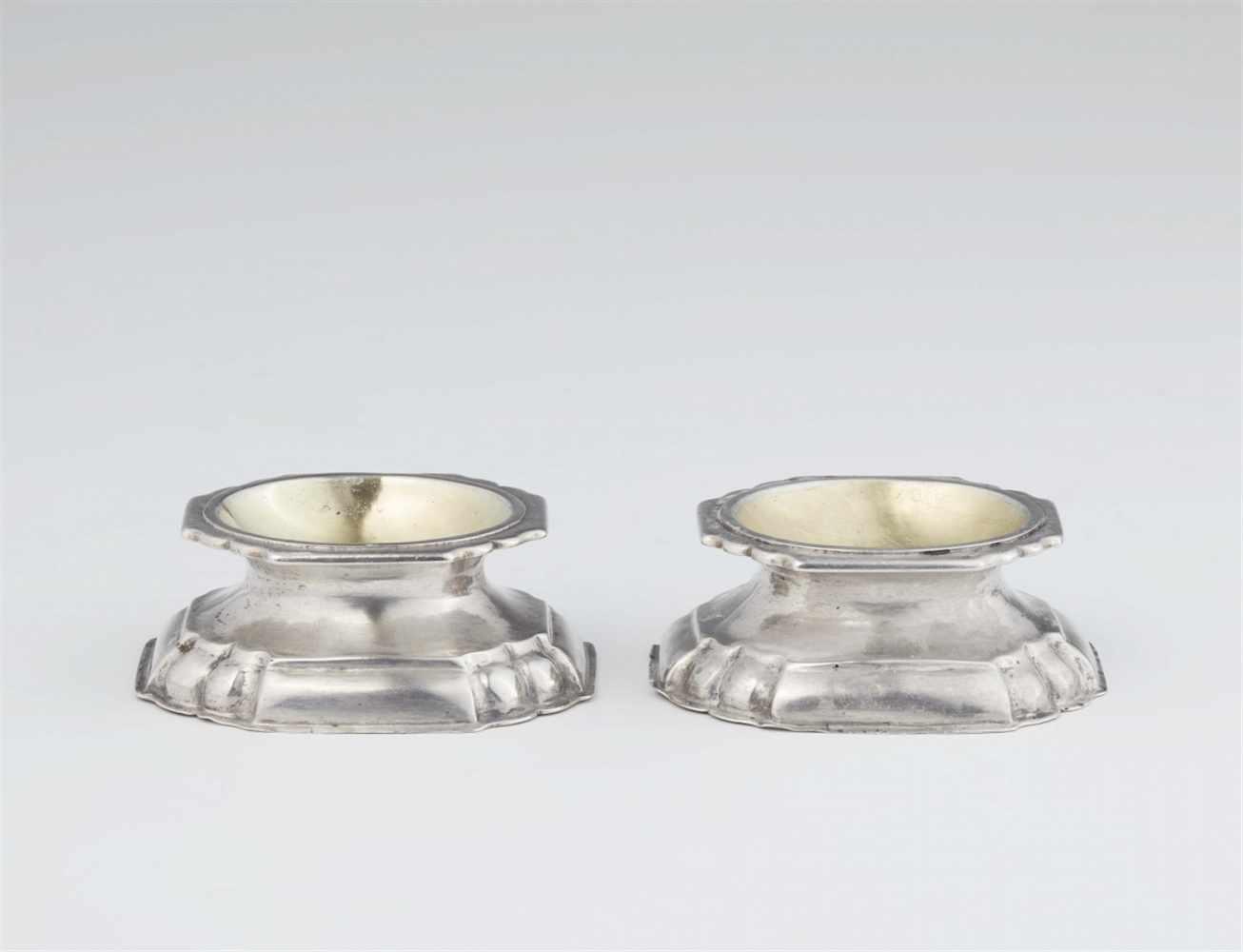 Lot 334 - A rare pair of Meiningen silver saltsInterior gilt rectangular salts with fluted decor. W 6.3; D 5