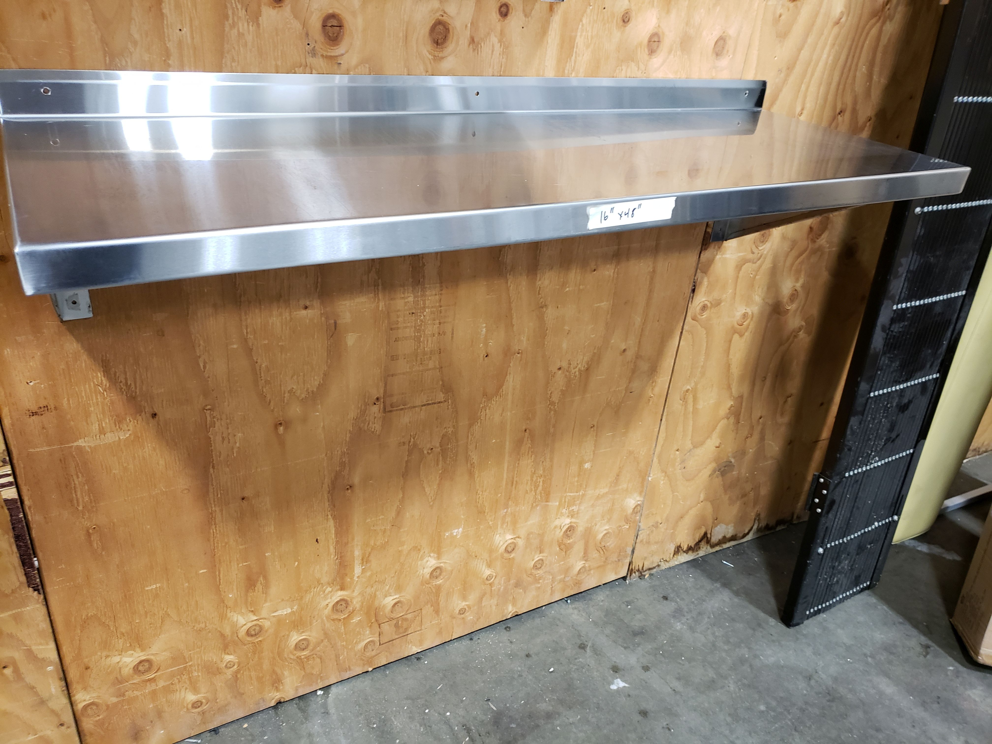 "Lot 22 - 16"" x 48"" Stainless Steel Wall Shelf"