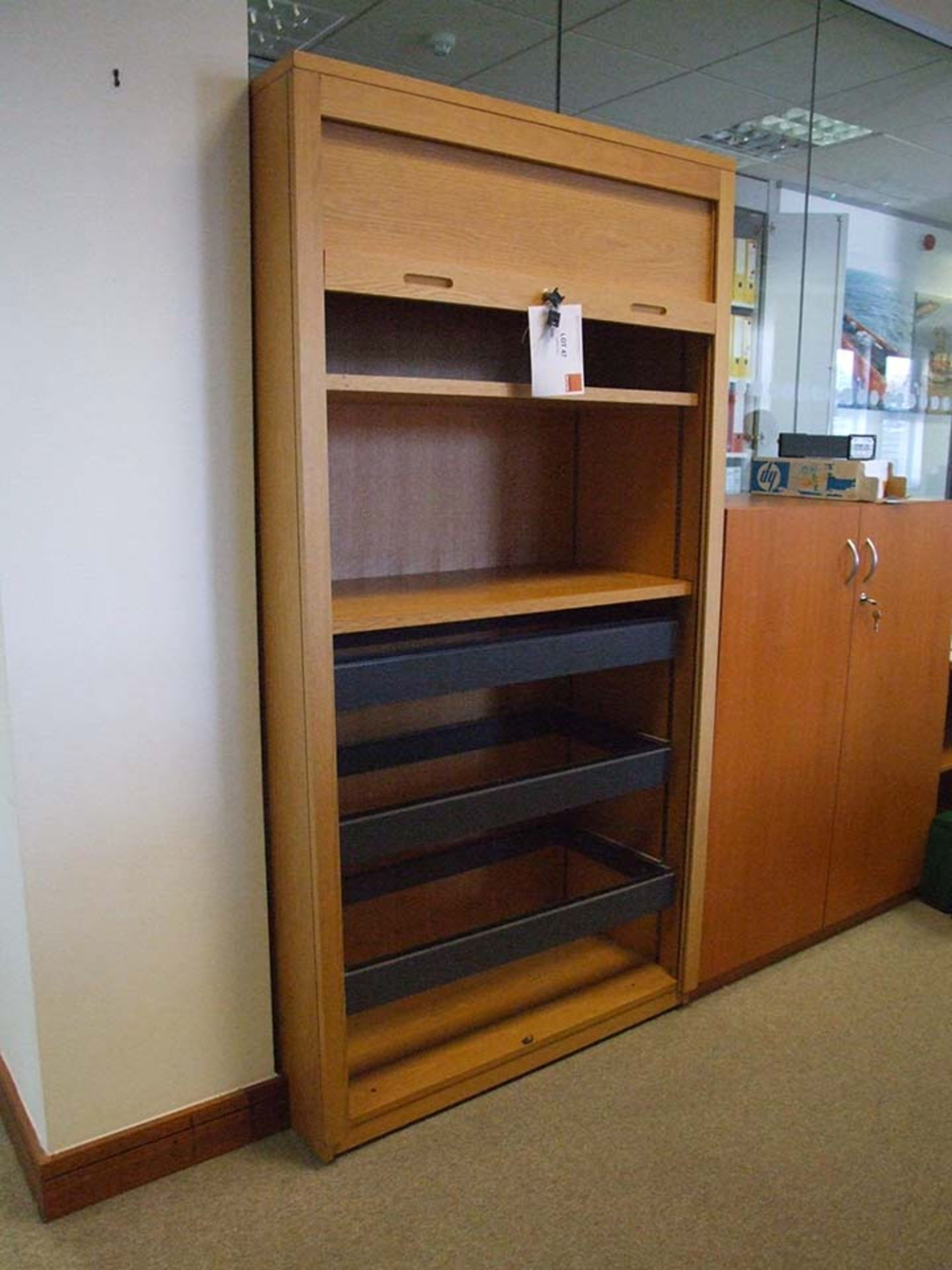 Lot 47 - Tall Roller Shutter cupboard with suspended filing system and shelves