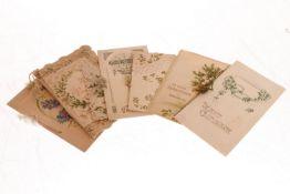 Konv. 7 Glückwunschkarten, meist um 1900, meist polychromer Prägedruck, tw Stanzspitze, leichte