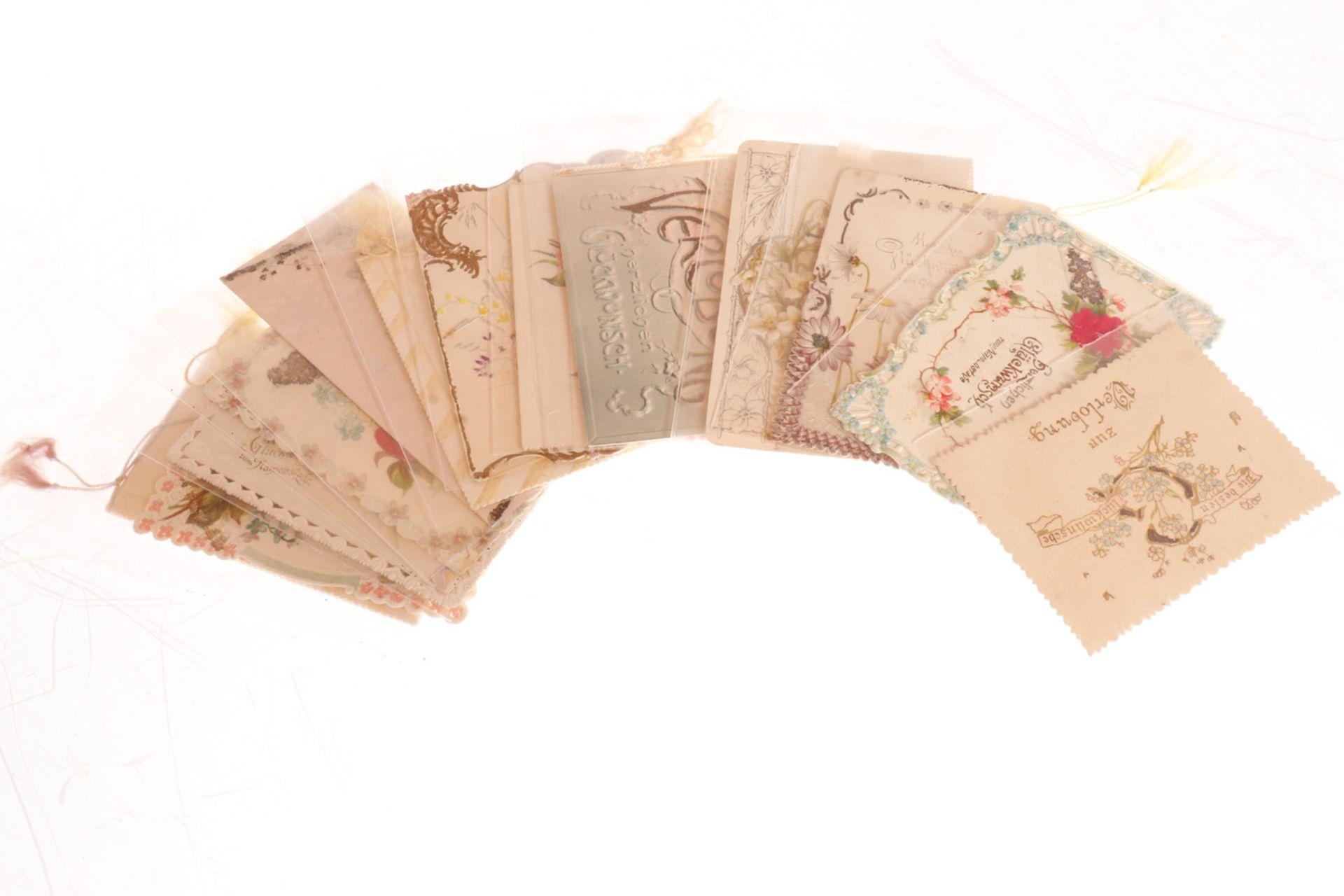 Konv. 15 Glückwunschkarten, um 1900, meist polychromer Prägedruck, tw Stanzspitze, leichte