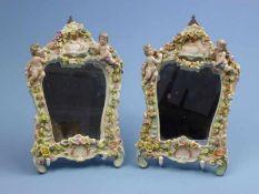 Paar Spiegel, Thüringen, 1.Hälfte 20.Jh. geschweifter Rahmen mit Putti, Rosengirlande,26x17cm