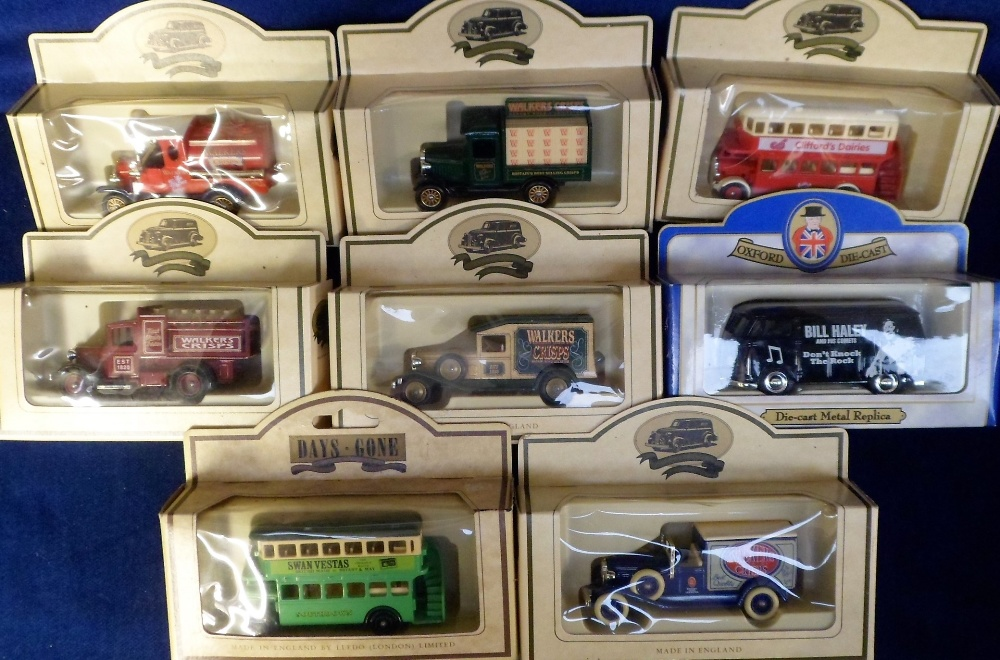 Lot 31 - Model Vehicles, 7 boxed Lledo lorries comprising 5 assorted Walkers Crisps vintage vehicles, a bus