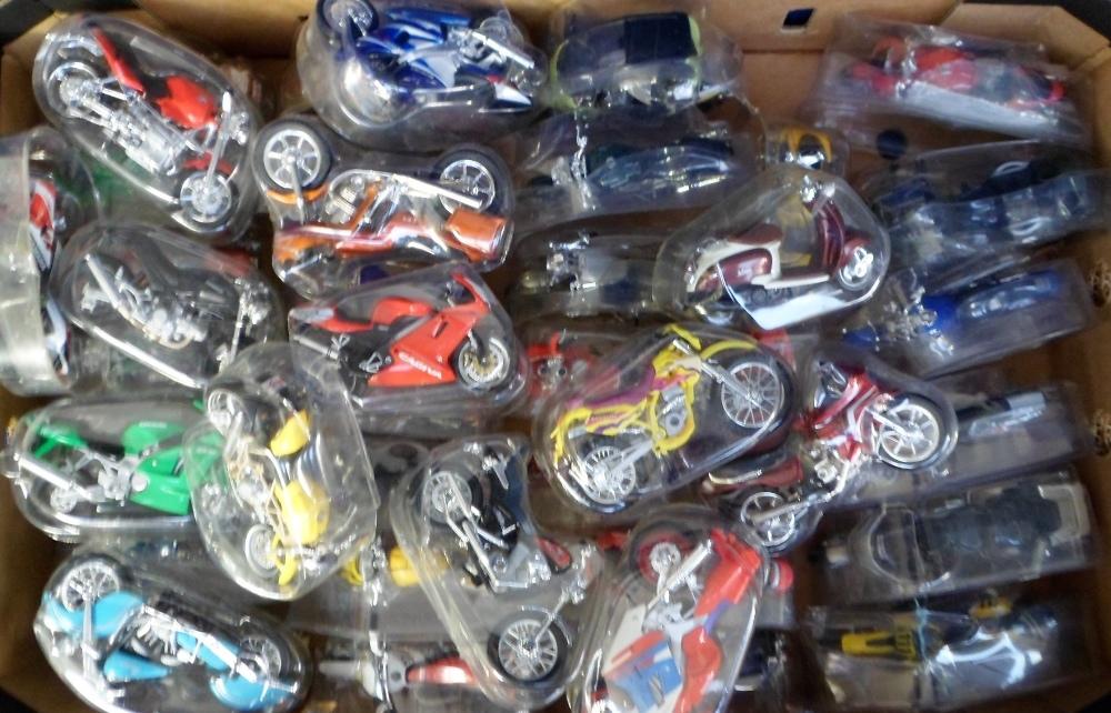 Lot 36 - Maisto Model Motorbikes, 75+ 1:18 scale Maisto model motorbikes in original plastic packaging