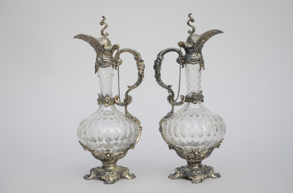 Lot 156 - A pair of cristal jugs with silverplated mounts (38cm)