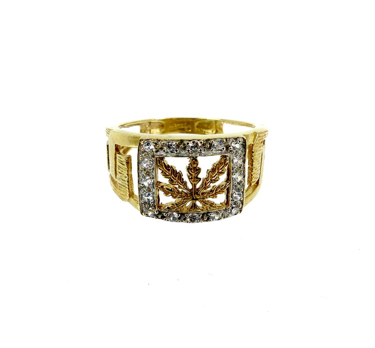 Lot 43 - A 9 Carat Yellow And White Gold Greek Key And Leaf Design Ring.