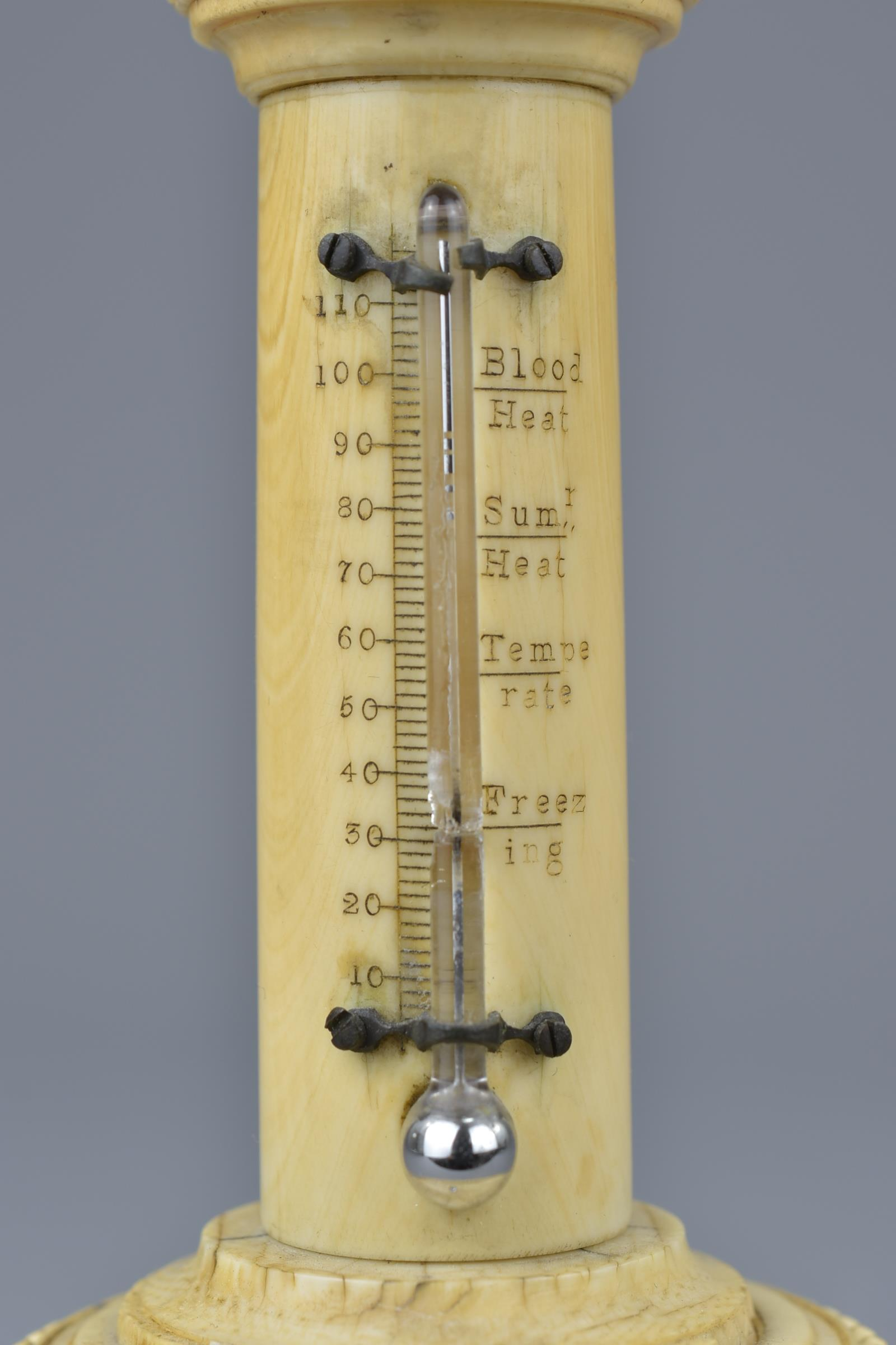 Lot 17 - An antique ivory thermometer. 18cm height