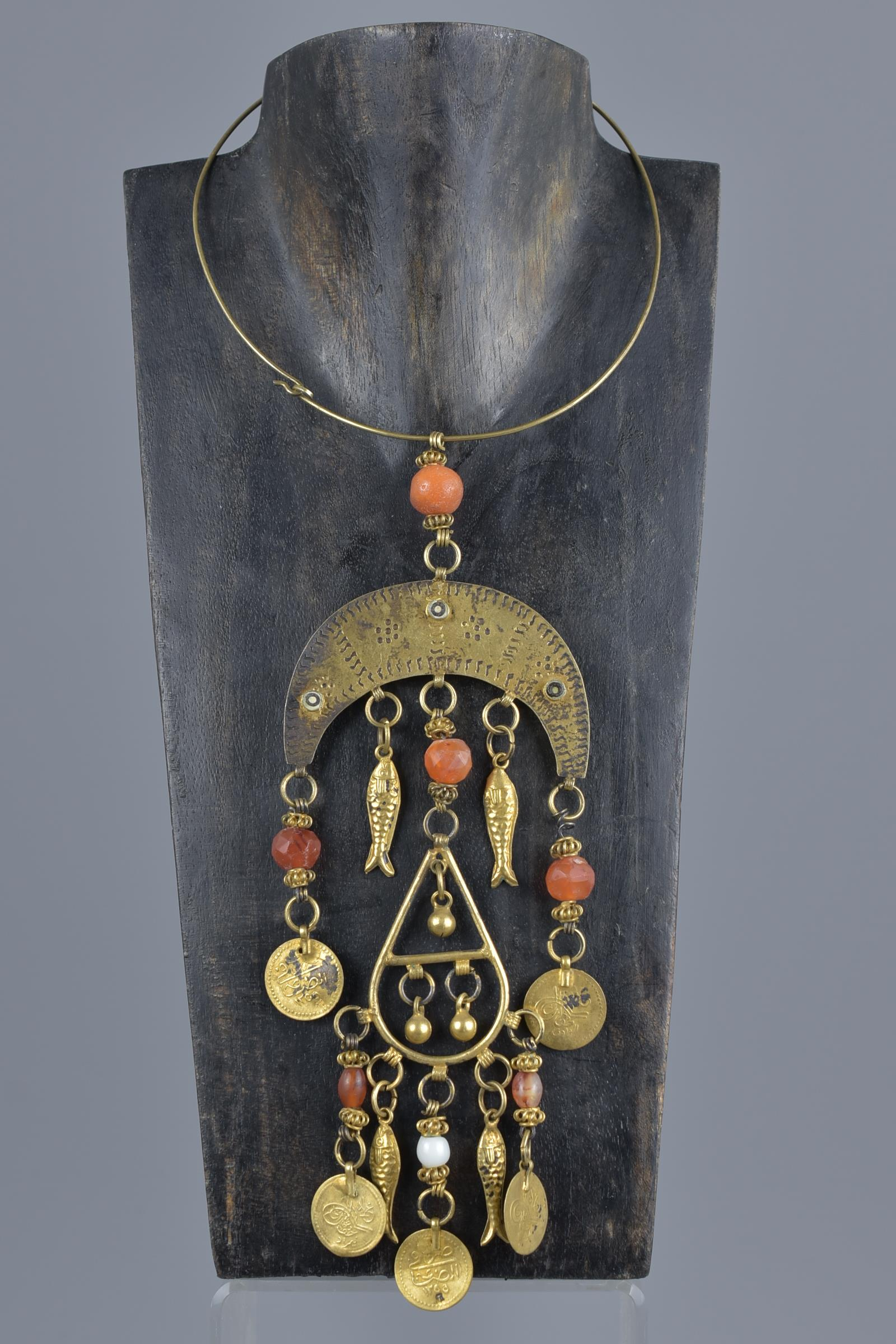 Lot 41 - A Islamic 19th century gilt metal necklace with beads and pendants inscribed.