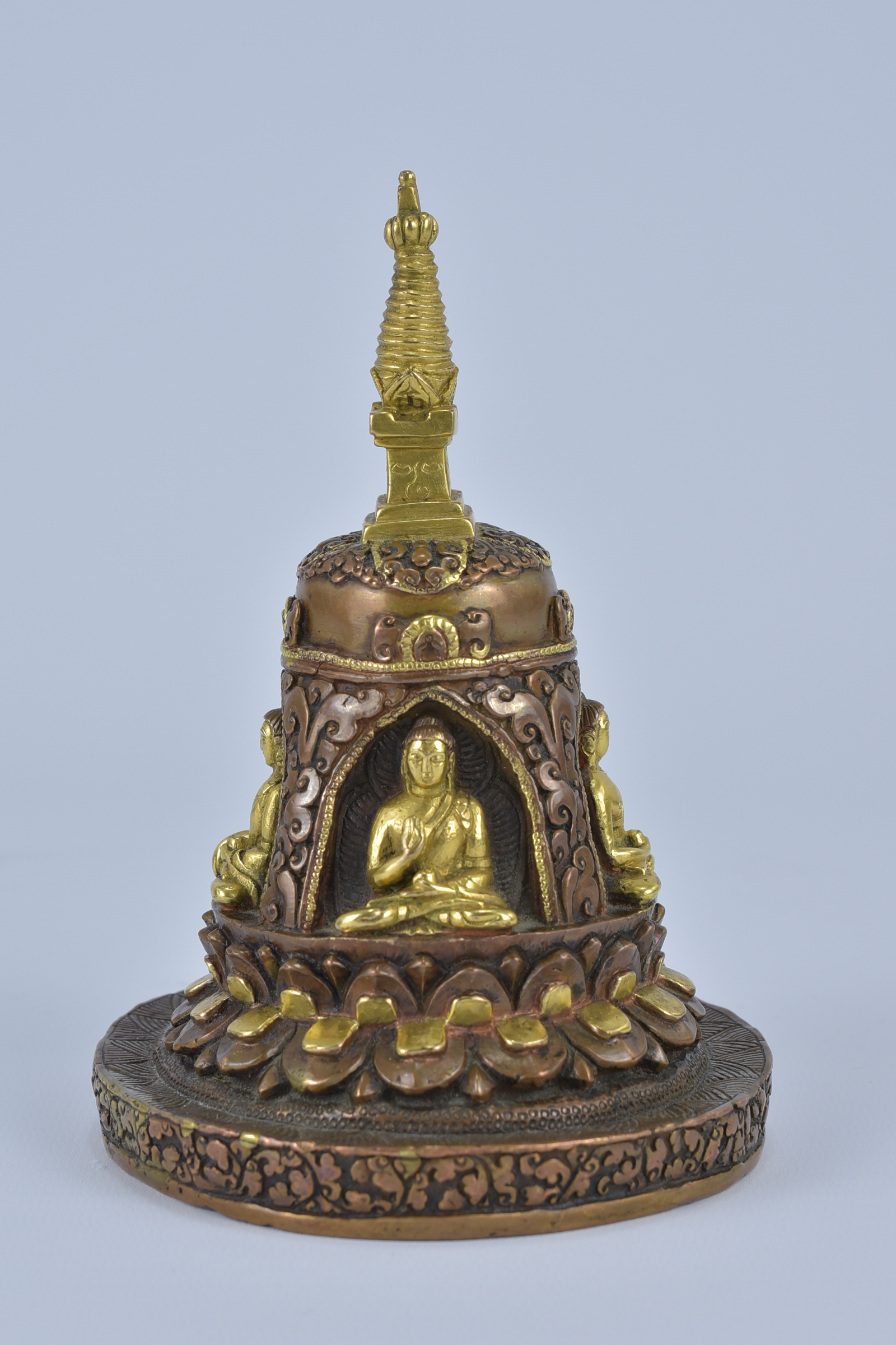 Lot 21 - A Tibetan bronze pagoda statue with four seated Buddhas. 16cm height