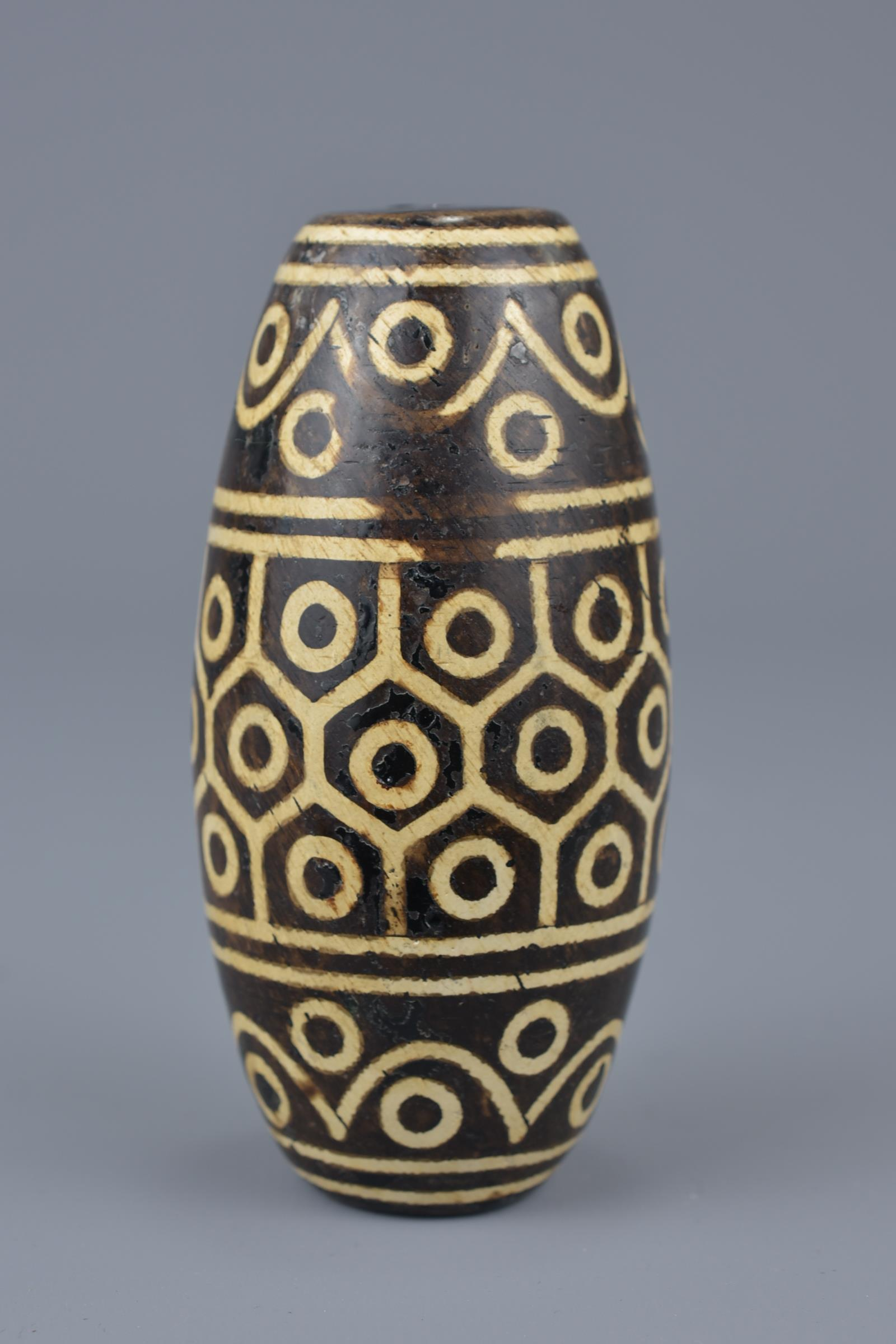 Lot 9 - A large Tibetan painted pottery bead Tianzhu style. 9cm width