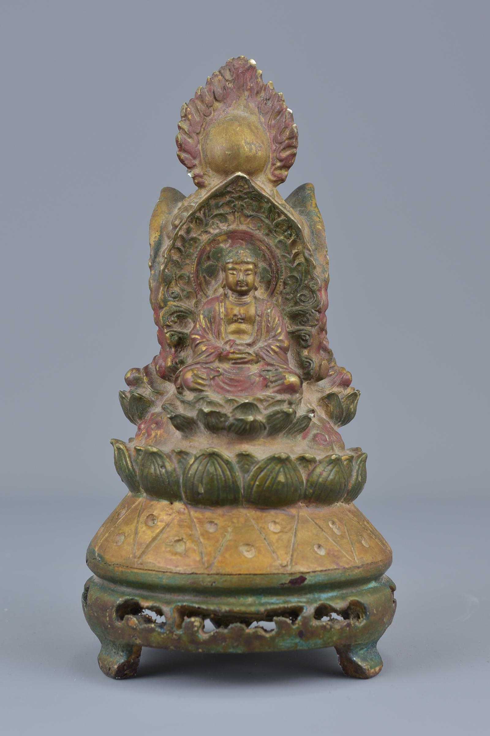 Lot 12 - A Tibetan wooden pagoda carved with three Buddhas on display stand. 24cm height