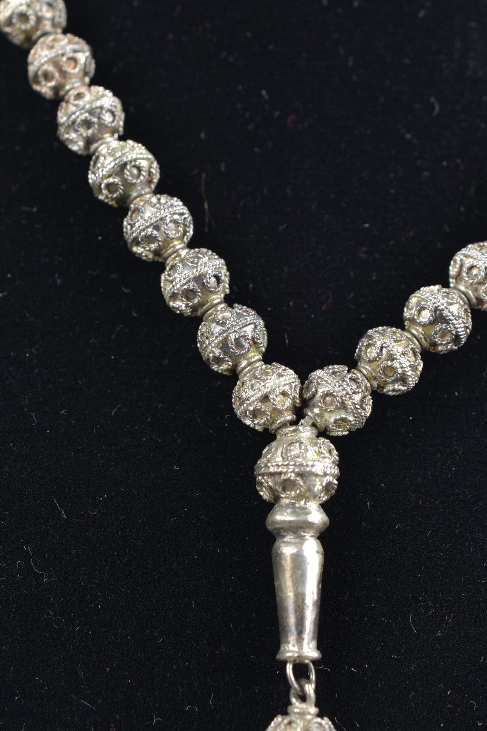 Lot 44 - Islamic 19/20th century silver-coloured metal prayer bead necklace