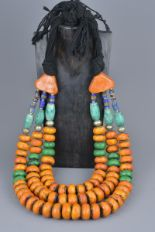 Lot 23 - A large Moroccan amber resin and blue stone necklace.