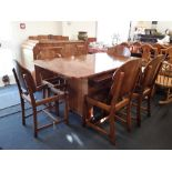 Lot 484 - A stunning Art Deco burr walnut extendable dining table and matching sideboard drinks cabinet.
