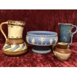 Lot 56 - Three assorted ceramic jugs and a Wedgwood pedestal fruit bowl.