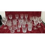 Lot 408 - A collection of 26 drinking glasses of various forms.