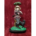 Lot 80 - A cast iron door stop in shape of a gamekeeper with black dog