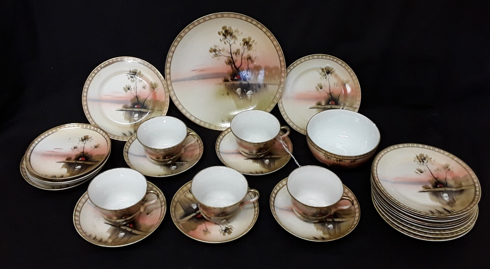 Lot 23 - A Nippon China hand painted part teaset.