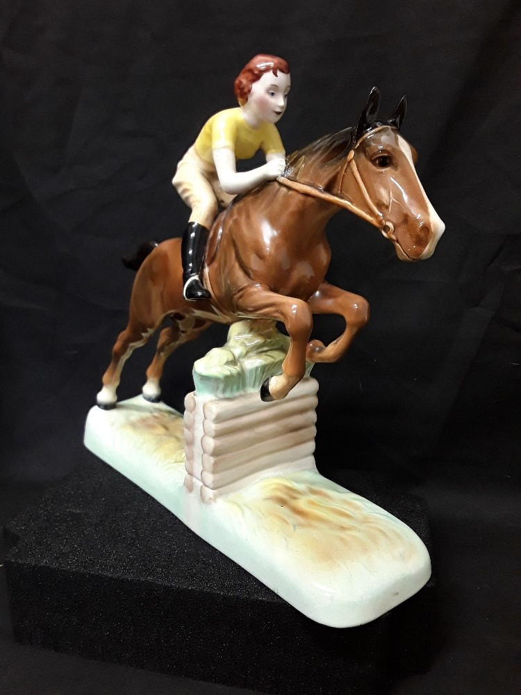 Lot 25 - A Beswick figurine of a girl on a jumping horse (excellent condition).