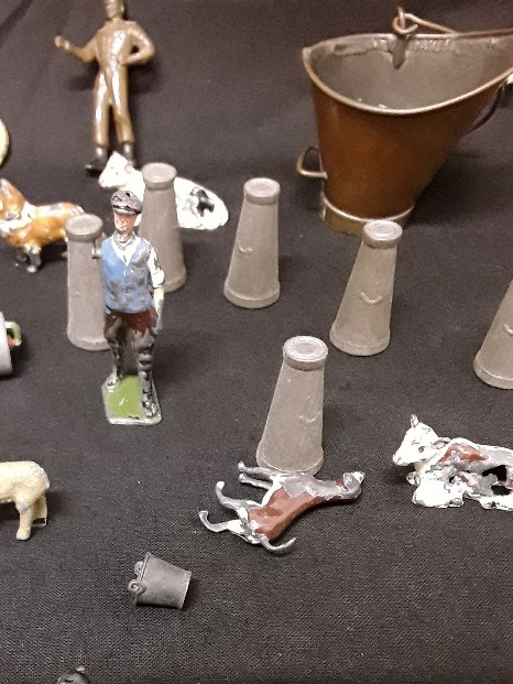 Lot 3 - A selection of lead toys including Britains Ltd farm animals and people.