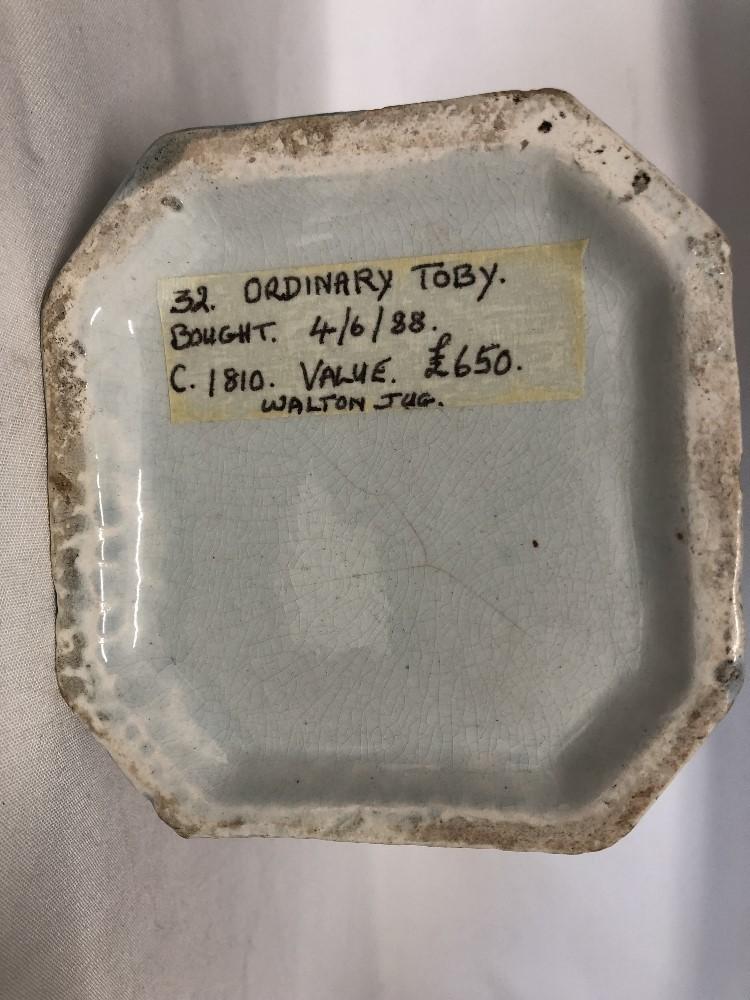 Lot 40 - A possible John Walton of Burslem toby jug (circa 1810).