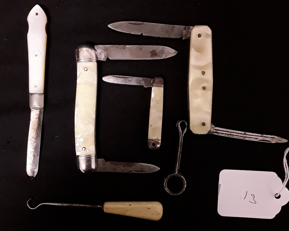 Lot 13 - A collection of fruit knives.