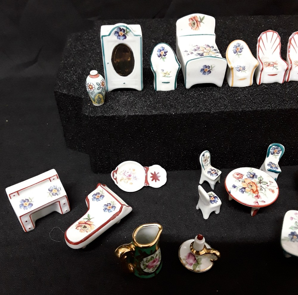 Lot 12 - A collection of miniature Limoges doll's house tea set items and furniture (23 items in total).